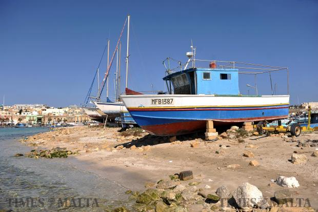 Boats winter their time away on land at Marsaxlokk on March 28. Photo: Chris Sant Fournier