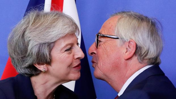British Prime Minister Theresa May is welcomed by European Commission President Jean-Claude Juncker.