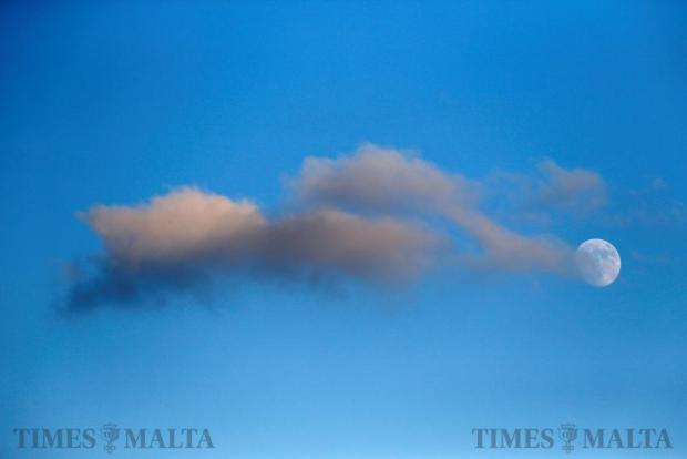 Clouds drift in front of the rising moon over Valletta just before sunset on December 11. Photo: Darrin Zammit Lupi