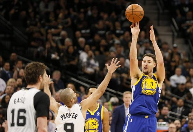 Golden State Warriors shooting guard Klay Thompson (11) shoots the ball over San Antonio Spurs point guard Tony Parker (9) in game three of the first round of the 2018 NBA Playoffs at AT&T Center. Photo Credit: Soobum Im-USA TODAY Sports