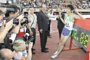 China`s Liu Xiang (right) after setting a new world record in the men`s 110-metre race in Lausanne.