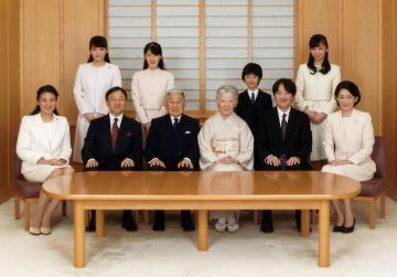 Japanese Emperor Akihito and Empress Michiko smile with their family members. Photo: Imperial Household Agency of Japan via Reuters