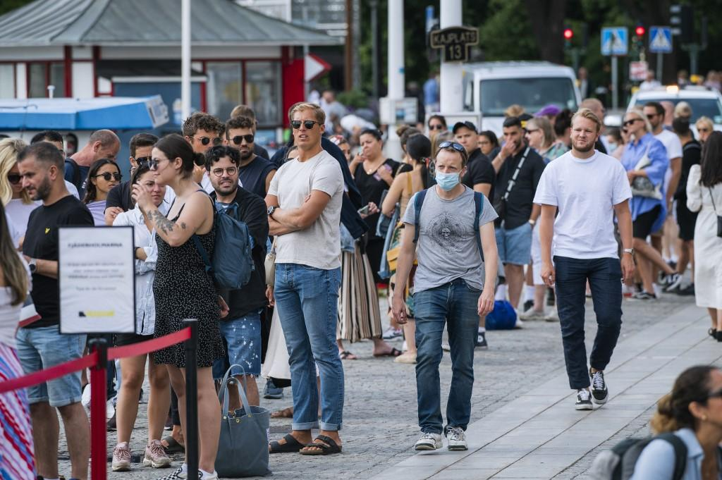 Travellers queue up to board a boat in Stockholm, Sweden on July 27. Photo: AFP