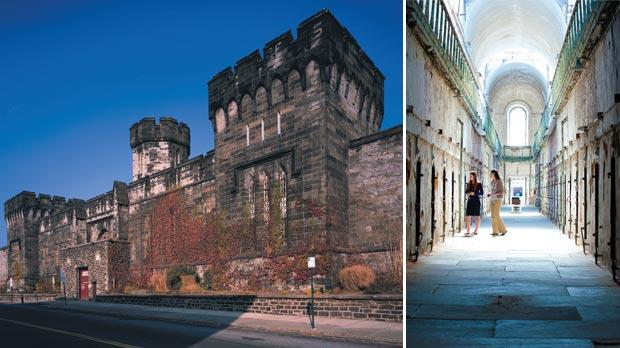The façade of Eastern State Penitentiary. Right: Visitors take the audio tour in Cell Block Seven. Photos: Jeff Fusco