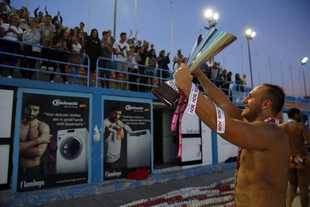 San Giljan's Dino Zammit shows the trophy to supporters after San Giljan beat Sliema in the Premier Division Winter League decider at the National Pool in Tal-Qroqq on April 27. Photo: Darrin Zammit Lupi