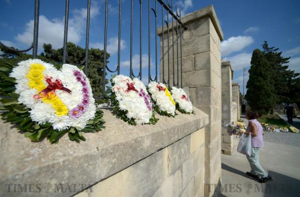 Flowers outside the Mosta cemetery greet the mourners who went to visit the graves of their dead relatives and friends on November 1, the eve of All Souls' Day. The day is celebrated by the Catholic Church to honour the dead. It is also recognised by some other Christian denominations. Photo: Matthew Mirabelli