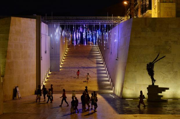 Iddi, an interactive visual installation created by Late Interactive for the Malta International Arts Festival, is mounted on the steps at the entrance to Valletta on July 16. By walking, running or dancing beneath the installation, participants' positions are tracked and reflected above in various colours and shapes. The concept of Iddi is to provide participants with an aura or glow that follows them wherever they move. Late Interactive is a collaboration between Maltese artists Andrew Schembri and Toni Gialanzè. Photo: Matthew Mirabelli