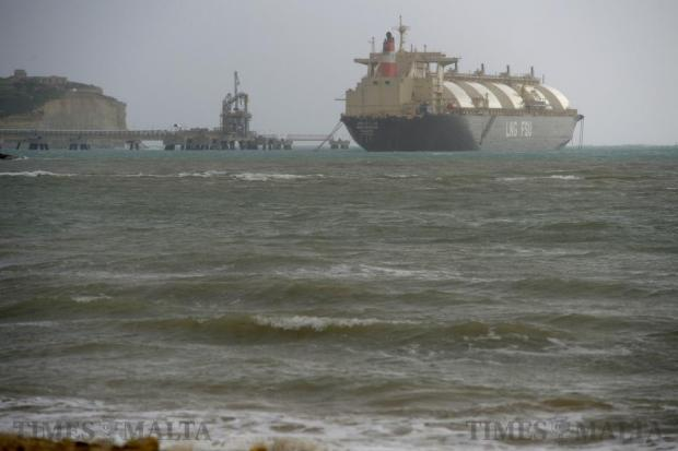 The LNG tanker is moved to its storm moorings as strong easterly winds hit the island on December 19. Photo: Matthew Mirabelli