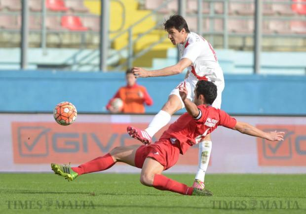 Valletta's Federico Falcone (right) gets a shot past Pembroke Athleta's Zoran Levanic during their BOV Premiership match at the National Stadium in Ta'Qali on March 13. Photo: Matthew Mirabelli