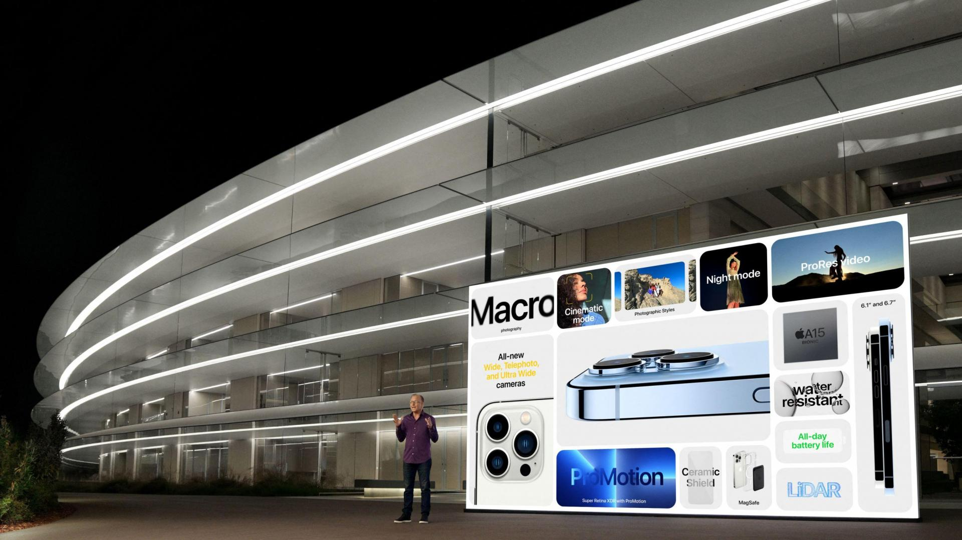 This handout image obtained September 14, 2021, courtesy of Apple Inc. shows Apple's senior vice president of Worldwide Marketing Greg Joswiak showcases the advanced features of the new iPhone 13 Pro and iPhone 13 Pro Max. Photo: Brooks Kraft/Apple Inc./AFP