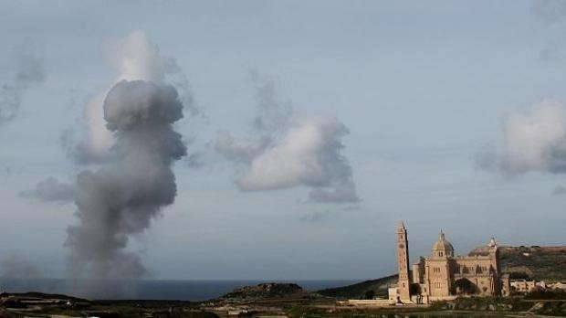 The plume of smoke towers over Ta' Pinu Church yesterday. Picture - Andrea Muscat - mynews@timesofmalta.com
