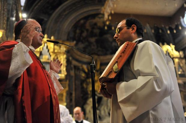 Archbishop Charles Scicluna reads the account of the Passion during a special Good Friday liturgy at St John's Co-Cathedral in Valletta on April 3. Photo: Jason Borg