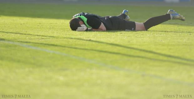 Naxxar Lions goalkeeper Julian Azzopardi lies on the floor after letting in a goal during their Premiership match against Floriana at the National Stadium in Ta'Qali on April 26. The Greens won the match 4-1. Photo: Matthew Mirabelli