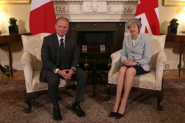 Joseph Muscat with Theresa May. Photo: AFP