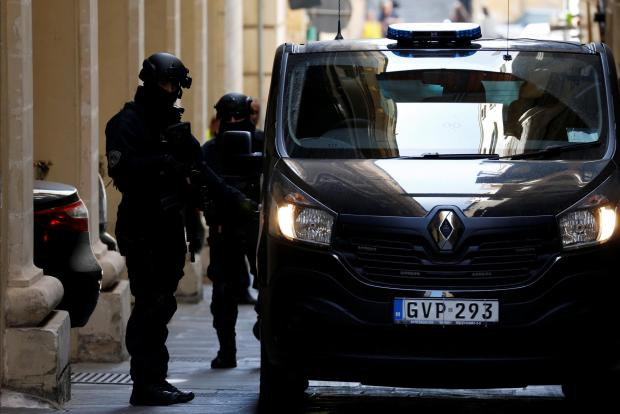 Armed police officers provide security as three men, accused of the assassination of Daphne Caruana Galizia, are taken to court. Photo: Reuters
