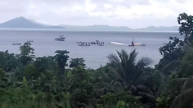 People are evacuated from an Air Niugini plane which crashed in the waters in Weno. Photo: Shutterstock