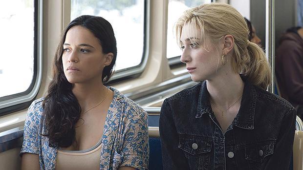 Michelle Rodriguez and Elizabeth Debicki in Widows.