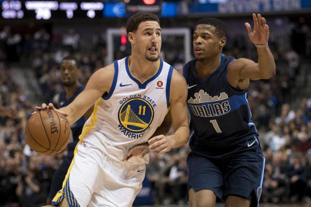 Golden State Warriors survived a frantic Dallas Mavericks rally for a 125-122 victory.