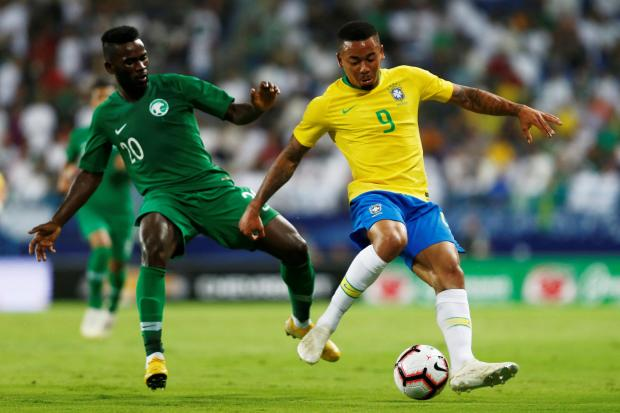 Gabriel Jesus moves past Abdulaziz Al-Bishi, of Saudi Arabia.