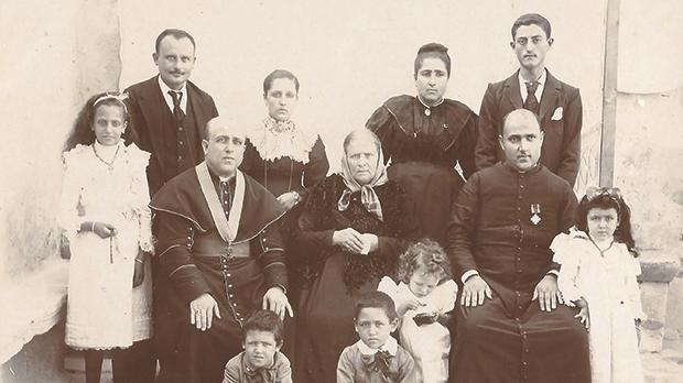 The Vella family. Don Luigi, wearing the decoration Pro Ecclesia et Pontefice, is seen second from right in the middle row. To his right (seated) is his mother Maria Teresa.