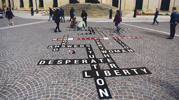 Letters shaped into a scrabble-like formation and pointedly asking 'Who Killed Daphne?' were laid out in Castille Square yesterday morning by Occupy Justice to mark the anniversary of Daphne Caruana Galizia's murder. Photo: Mark Zammit Cordina
