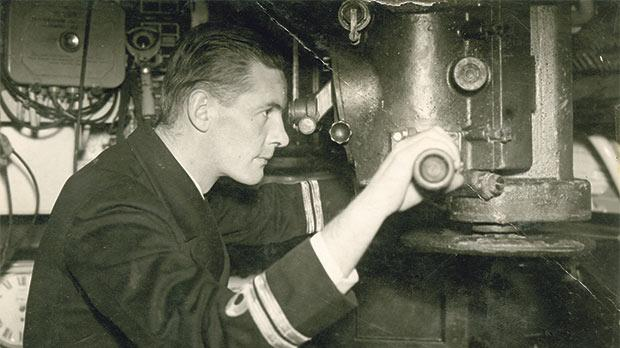 Lieutenant L.W.A. Bennington, Commander of the British submarine HMS Porpoise, peering through the periscope during the Battle for the Mediterranean in 1942.