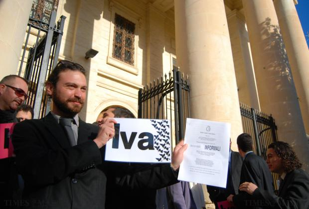 A Birdlife member holds a Yes (Iva) placard outside court on January 9 after the court ruled that the referendum would go ahead. Photo: Mark Zammit Cordina