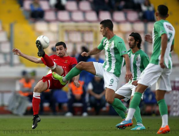 Valletta's Ryan Fenech (left) clears the ball from Floriana's Vito Plut (centre) during their Premier League football match at the National Stadium in Ta' Qali on December 6. Photo: Darrin Zammit Lupi