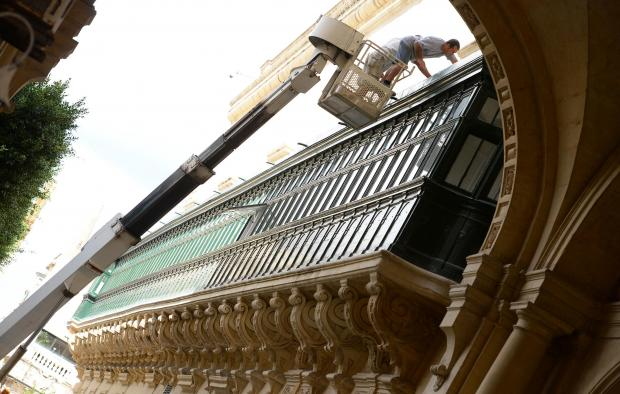 Two men conduct maintenance works on the balcony of the Grand Master's Palace in Valletta on October 10. The enclosed wooden balcony is richly decorated with sculptured corbels and wraps around the corners of the building's facade. Photo: Matthew Mirabelli