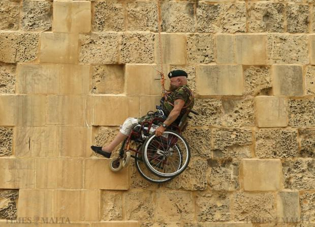 British former police officer Swasie Turner abseils for charity in a wheelchair down the fortification bastions of Valletta on April 27. Turner has wheeled himself more than 38,000 miles and raised over £1 million for charity since 1997 after losing his wife to cancer. The traumatic loss came months after he was confined to a wheelchair when he was deliberately run down by a motorcycle while on duty as a police officer. Photo: Darrin Zammit Lupi