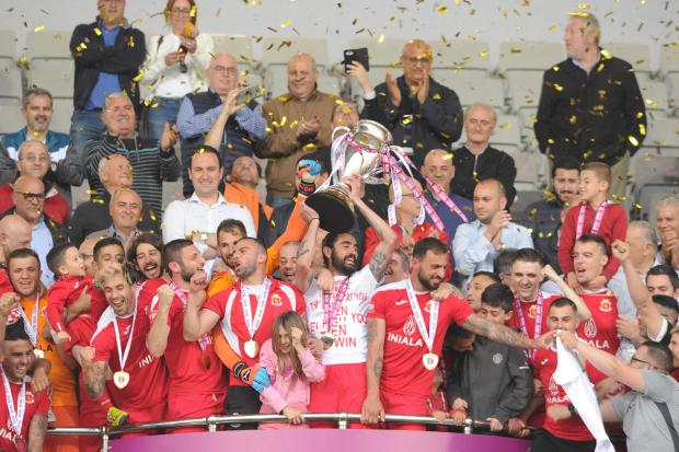 Valletta players lift the Premier League trophy after defeating Hibernians in the title decider. PHOTO: STEPHEN GATT