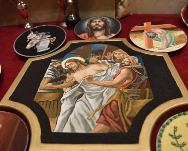 Paintings depicting the way of the cross made out of salt in in Cospicua on March 27. Photo: Mark Zammit Cordina