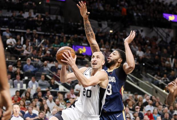 San Antonio Spurs shooting guard Manu Ginobili (20) drives to the basket past New Orleans Pelicans power forward Anthony Davis (23) during the first half at AT&T Center. Photo Credit: Soobum Im-USA TODAY Sports