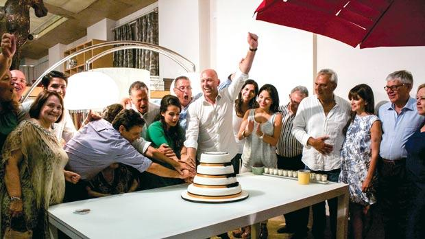 The Camilleriparismode family proudly cuts the cake.