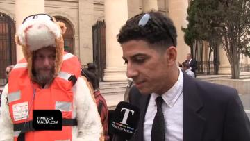 Watch: Activists dress as dogs, with life vests, in migrant ship protest   Video: Chris Sant Fournier