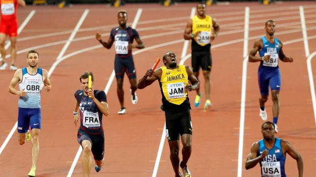 Usain Bolt of Jamaica appears injured during the final.
