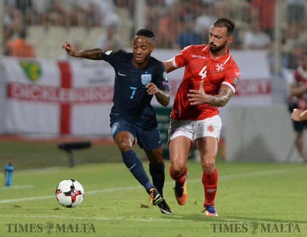England' s Raheem Sterling (left) and Malta's Steve Borg compete for the ball during their FIFA 2018 World cup Qualifying Group F Match at the National Stadium in Ta'Qali on September 1. Photo: Matthew Mirabelli