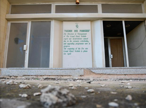 A sign at the main entrance of the Grand Hotel Verdala in Rabat, promises that it will reopen soon but 17 years later, the hotel is still in ruins. July 25. Photo : Jonathan Borg