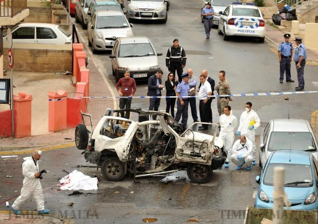 The lifeless body of a 67-year old Naxxar businessman lies beside the wreckage of his car in Bugibba on October 31. The man is thought to have been killed when a bomb placed under his car exploded as he was driving down Paderbon Street. Photo: Chris Sant Fournier