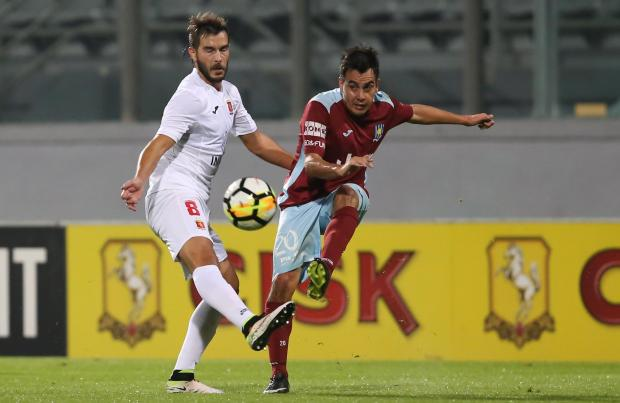 Edison Zarate of Gżira United (right) attempts a pass despite Valletta's Santiago Malano pressure. Photo: Christine Borg