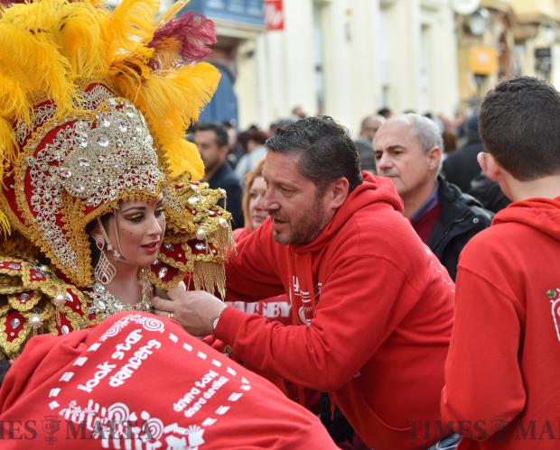 Helpers arrange a woman's costume in Valletta during carnival on February 11. Photo: Mark Zammit Cordina