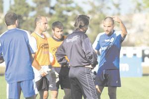 Coach Oliver Spiteri (centre) talking to striker Andre Schembri during training.