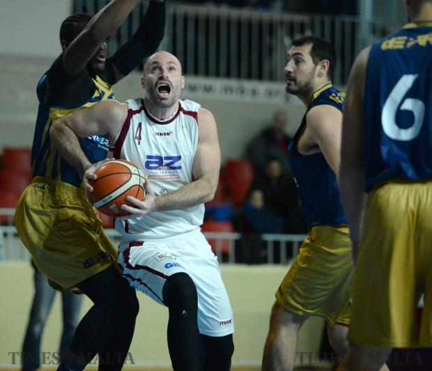 Gzira Athleta's Michael Naudi (centre) try's to take a shot during their match against Depiro on January 15 at the Basketball Pavilion in Ta'Qali. Photo: Matthew Mirabelli