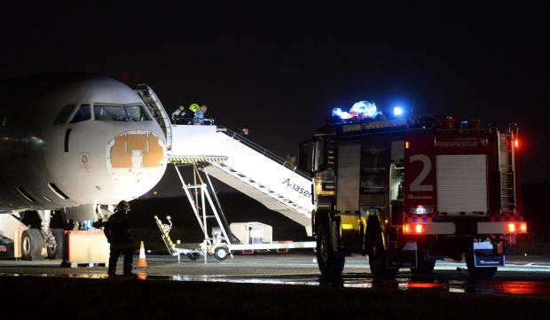 People are evacuated off an airplane during a full-scale emergency exercise at the Malta International Airport on March 27, to test the preparedness of key stakeholders that would be mobilsed in the event of a real-life accident at the airport. Photo: Matthew Mirabelli