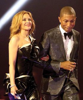 Kylie Minogue with Pharrell Williams. Photo: Yui Mok/PA Wire