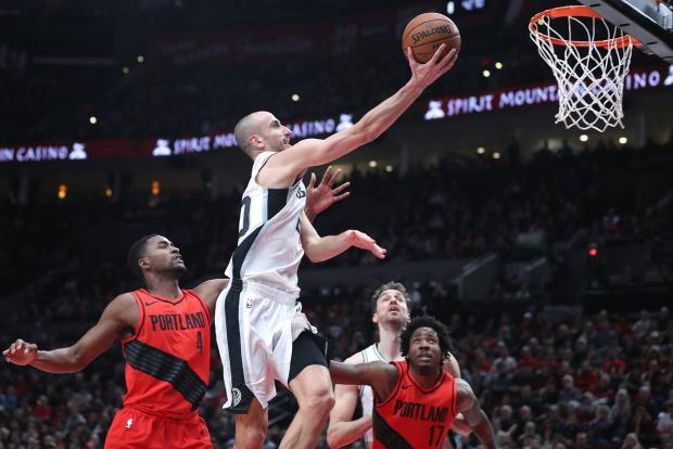 San Antonio Spurs guard Manu Ginobili (20) shoots over Portland Trail Blazers forward Maurice Harkless (4) and Trail Blazers' forward Ed Davis (17) in the first half at Moda Center. Photo: Jaime Valdez-USA TODAY Sports