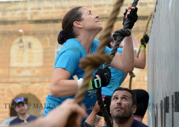 A participant makes her way up the last obstacle whilst taking part in The Grid obstacle course race in Pembroke on May 29. The race, the first of its kind in Malta, covered 15km and included over 30 obstacles. Photo: Matthew Mirabelli