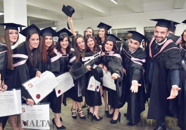 Students celebrate after their graduation ceremony at the Malta University on November 13. Photo: Mark Zammit Cordina
