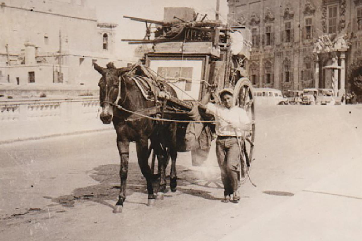 A refugee leaves Valletta with everything he can carry on his horse and cart.