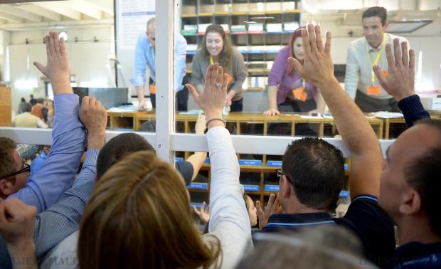 Nationalist Party agents bang on the perspex, as the final votes are counted electing Karl Gouder as Mayor of St Julian's during the Local Council Elections vote counting in Naxxar on April 18. Photo: Matthew Mirabelli